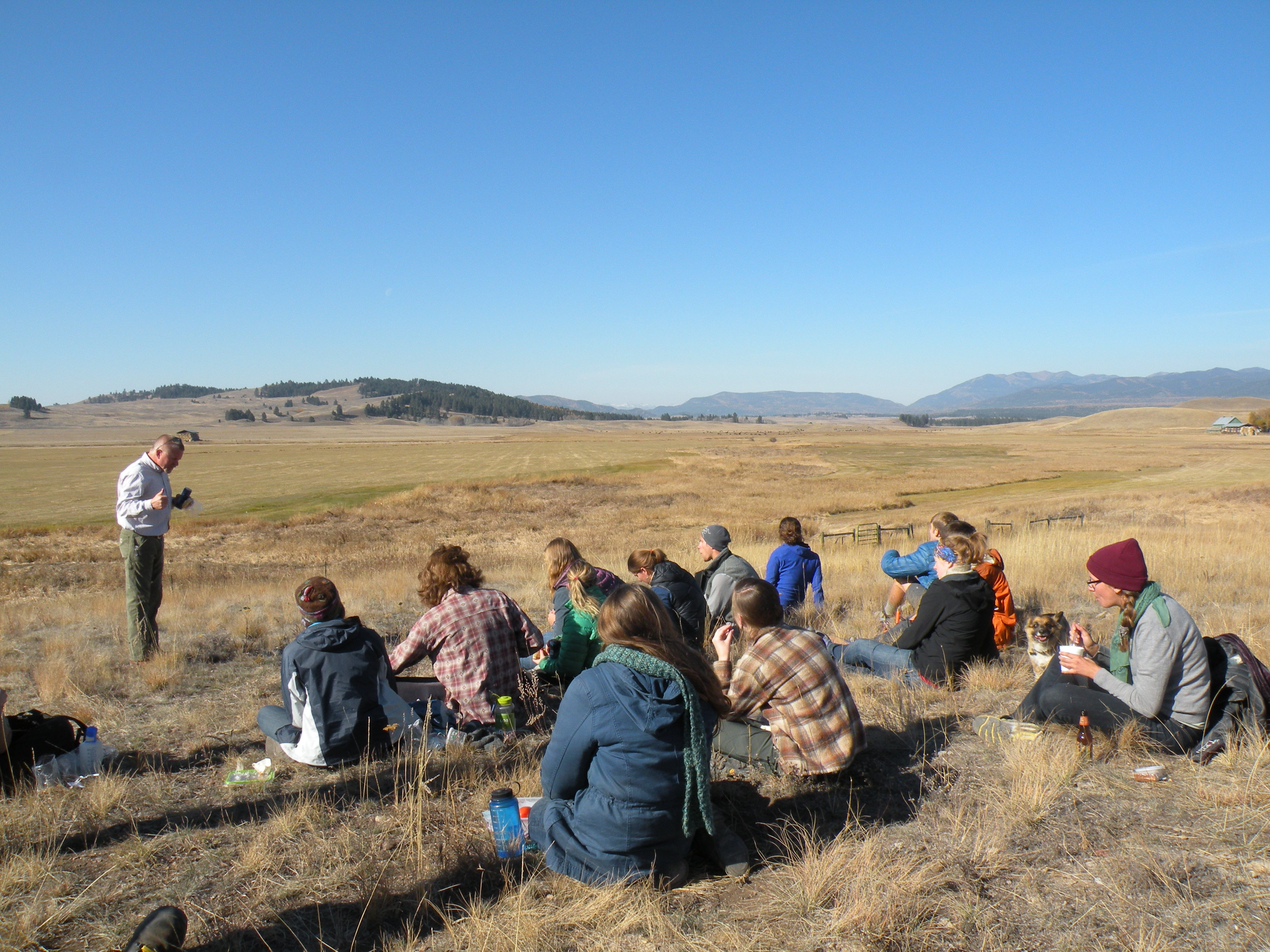 students learn in field from jim stone