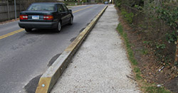 Physical barriers such as wooden or concrete curbs